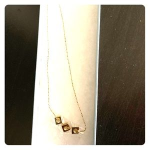 Triad gold pendant necklace
